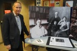 Richard Hughes, chair of the Dr. James B. Collip Recognition Committee, next to the committee's display of the famed local doctor. The display was set up at the Belleville Public Library in celebration of Dr. James B. Collip Day on Nov. 20. Photo by Joseph Quigley