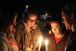 Loyalist students (left to right) Amanda Woolley, Caitlyn Lyver, Lindsay Down and Quintin Jolliffe huddle together to light their candles during Sunday night's vigil. Photo by Samantha Reed, QNet News