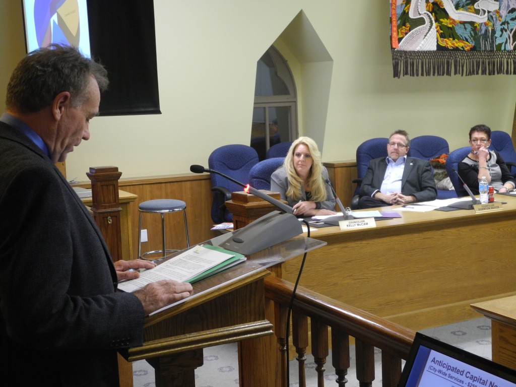 Quinte Home Builders Association president Gord McCrady (left) speaks to city council about why they should not raise development charges as much as a new study recommends. Councillors Kelly McCaw, Edgerton Boyce and Jackie Denyes (far right) listen with the rest of city council. Photo by Joseph Quigley, QNet News
