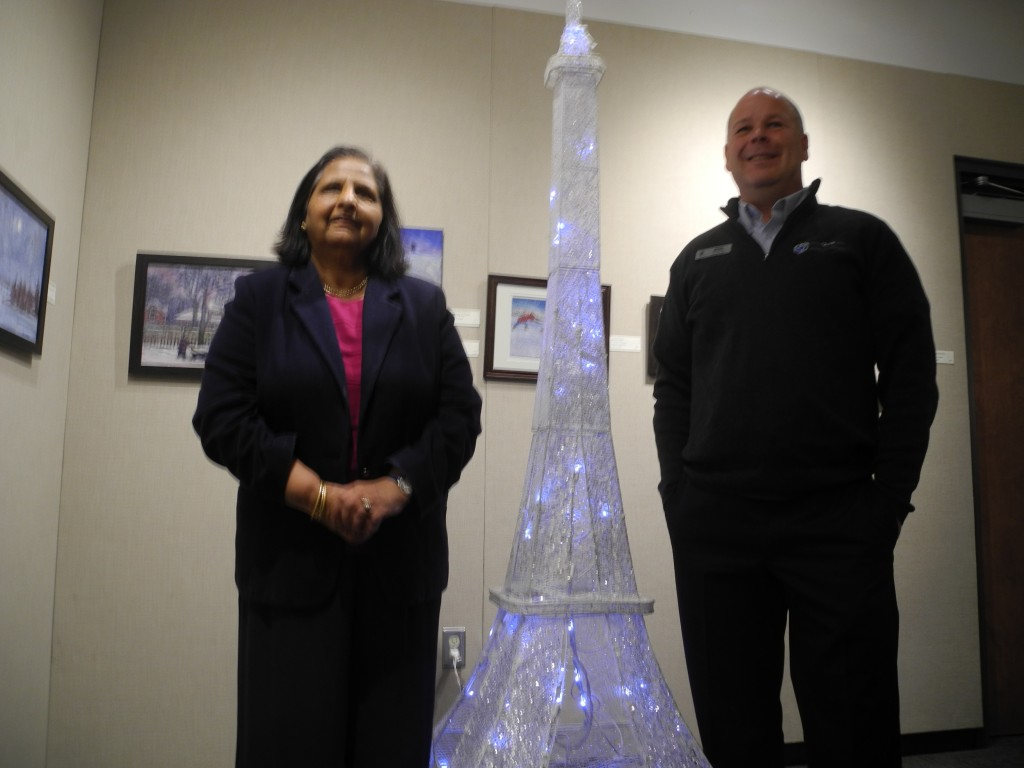 Dr. Aruna Alexander (left), fouding president of the United Nation Association in Canada Quinte Branch and Quinte Conservation hydrogeologist Mark Boone next to a miniature Eiffel Tower at the Bellevlle climate conference. The conference was inspired by the U.N. climate change talks in Paris. Photo by Joseph Quigley, QNet News
