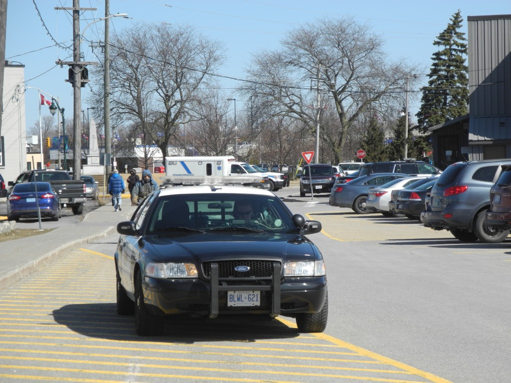 OPP police and other emergency responders parked outside Quinte West City Hall Tuesday Morning. Photo by Joseph Quigley, QNet News