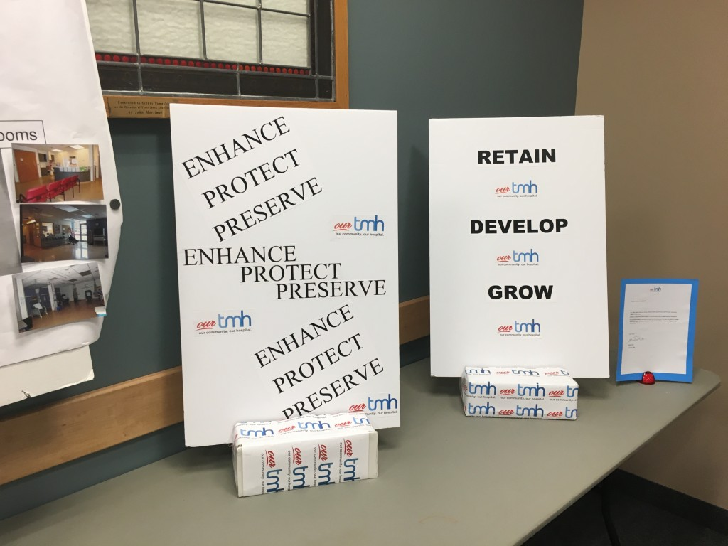 Signs and posters were put on display for attendees at Our TMH's public information meeting on Wednesday night. Photo by Brock Ormond, QNet News.