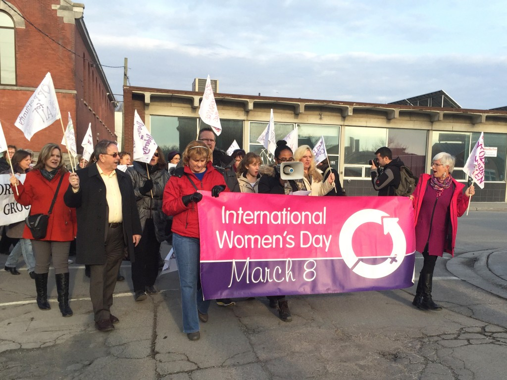 About 40 people came out on Tuesday evening to join the International WOmen's Day march to support women's rights worldwide. Photo by Stephanie Clue, QNet News.