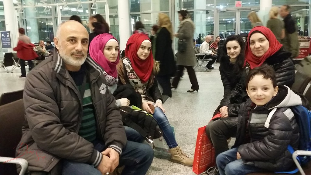 First Syrian refugee family arrives at the Toronto Pearson Airport on Dec. 9 2015. Photo courtesy of Domnic Santiago.