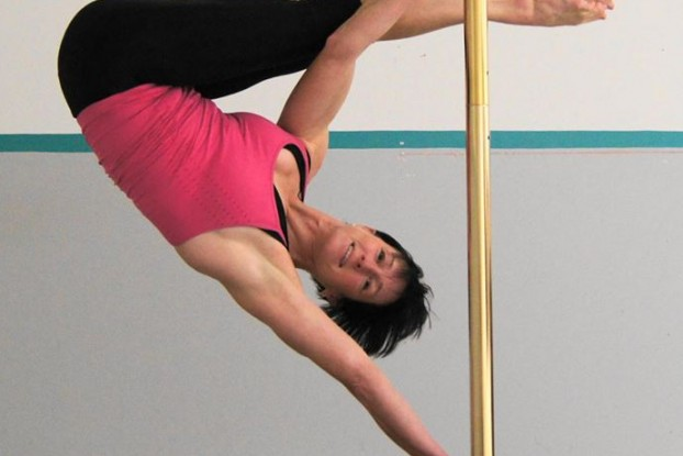 Alison Kemp, pole fitness instructor at Belleville's 121 Fitness, showing off her balancing skills. Photo from Kemp's Facebook.