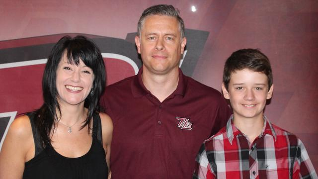 Former Belleville Bulls assistant coach and forward Jake Grimes poses for a picture with his wife Kim and son Dixon at his introductory press conference in Peterborough on May 26, 2015. Photo courtesy: Peterborough Petes