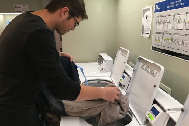Simon Sheehan, a second-year student from Oshawa, Ont., says he still struggles to do his laundry, and has had to make many calls to his mom for help. Photo By Deanna Fraser, QNet News