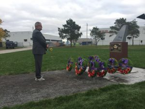 Monty Montgomery, a survivor of Boxtop Flight 22, pays silent tribute to those who died. Photo by Selena Steele-Clough, QNet News