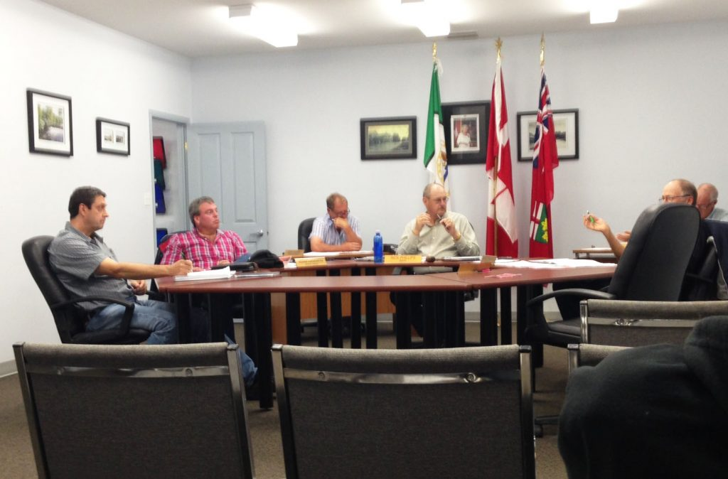 Councillors at Tyendinaga Township vote on Tuesday night's meeting to apply for the provinces OCIF funding. Photo by Charlotte McParland, QNet News