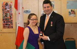 Nicole Flynn receiving her Queen Elizabeth II Award from Toronto councillor Dan Harris. Photo courtesy of nicoleflynn.ca
