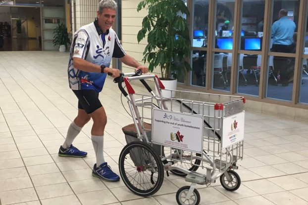 Joe Roberts has been travelling across Canada with his custom shopping cart since the beginning of May. Photo by QNet News reporter Tara Henley.