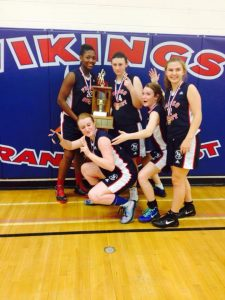 Kylea Galipeau-Wilson (second from the right) celebrates with her teammates in 2013. Photo courtesy of Facebook