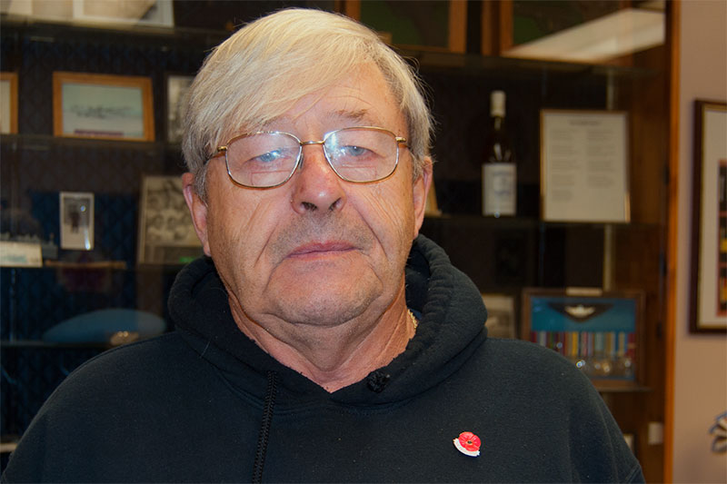 Wayne Monaghan, a 32-year-veteran and 20-year-legion member displays his poppy pin at Royal Canadian Legion Branch 110 in Quinte West. He says he has seen plenty of support from the community during this year's poppy campaign. Photo by Matthew Murray, QNet News.
