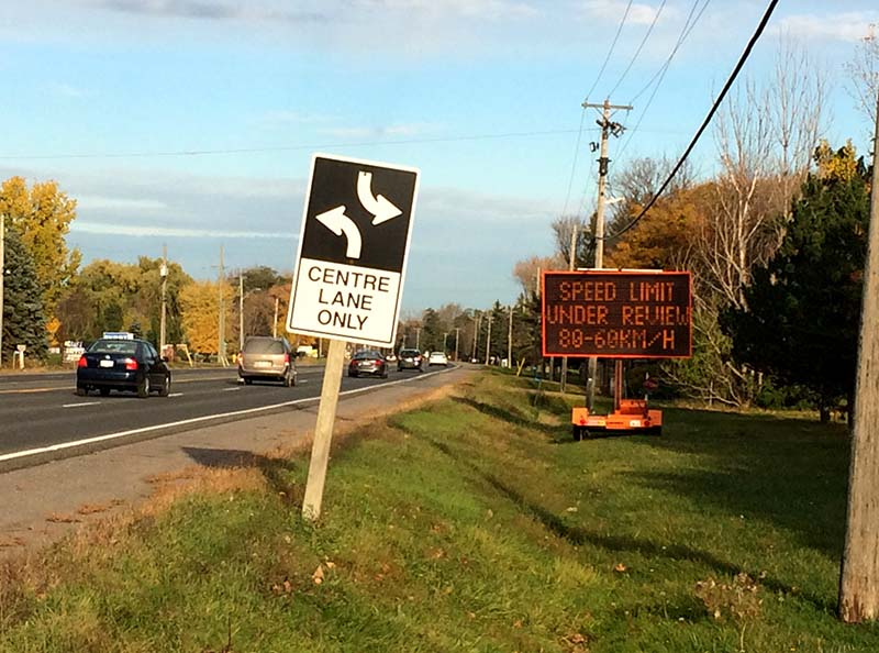 Signs on Highway 2 in Quinte West warn drivers about a potential speed limit change.