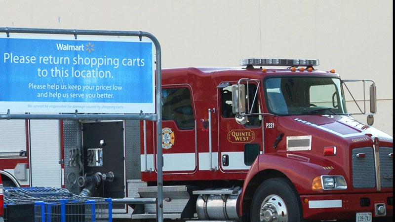 Fire trucks sit outside the Walmart in Trenton hours after a fire broke out in the storage room of the store. Photo by Brock Ormond, QNet News