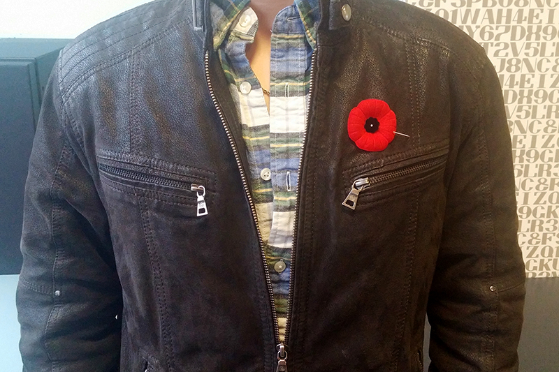 The appropriate way to wear a poppy; on the left side and close to the heart. Photo by Matthew Murray, QNet News