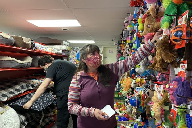 Store owner Suzanne Dufort has run this pet store for over 25 years and says she will miss serving the customers. Chris Parbery, standing behind Dufort, has worked with Dufort the past four years and will continue to work at the store. Photo by Maria Toews, QNet News